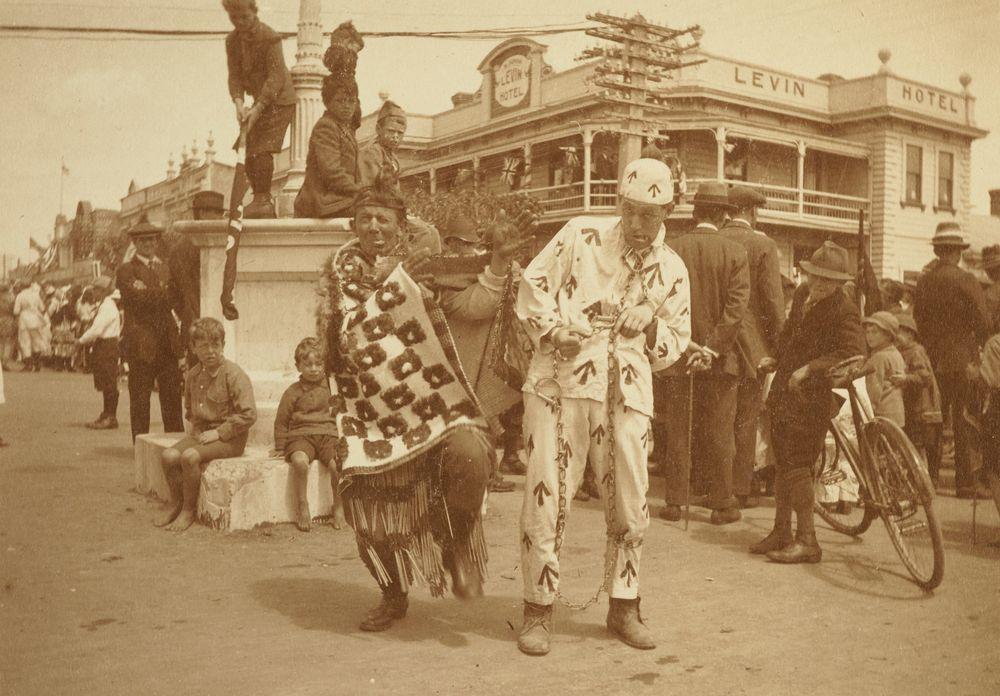 """A Maori Chief (Mr F. Proctor) & a convict (Mr. G. Noble)"": 'Armistice Celebrations in Levin, Nov. 13. 1918'. From the album: Family photograph album; 1917 - 1920; Adkin, Leslie - Museum of New Zealand Te Papa Tongarewa"