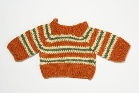 GH014703; Doll's clothes, pullover; 1974 - 1988; Television New Zealand (image/jpeg)