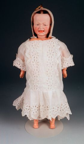 The doll with three faces that inspired Max's story Doll, circa 1900, made by Gebruder Heubach, Germany Gift of the Browne Family, 1982
