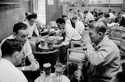 [Men drinking in pub]