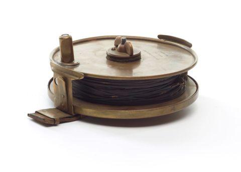 Surveyor's steel band measuring tape.