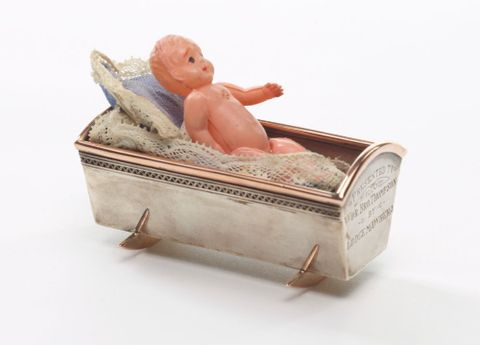GH011307; Presentation cradle with doll; 1927; Grady, Frank (image/tiff)