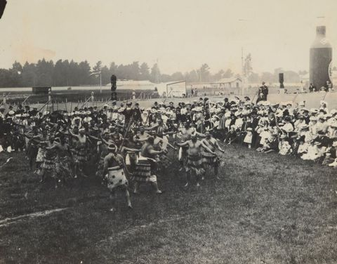 Maori kapa haka (dance performance) before a large European audience, early 20th century