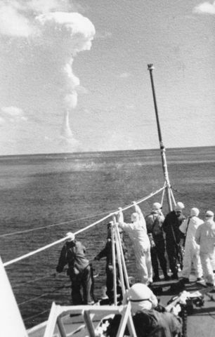 The crew of HMNZS Pukaki look towards ground zero after a British nuclear test at Kiritimati (Christmas Island)
