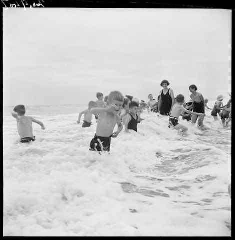 Children play in the sea at Otaki Health Camp