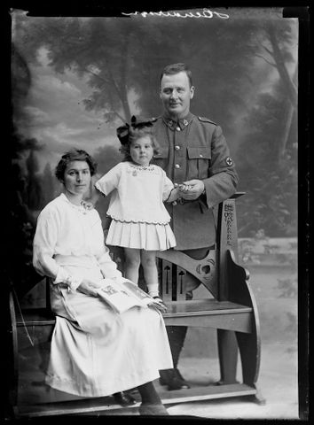 Group portrait of an unidentified soldier, an unidentified woman and an unidentified girl inscribed Henderson, 1914-1919, Wellington. Berry & Co. Purchased 1998 with New Zealand Lottery Grants Board funds. Te Papa