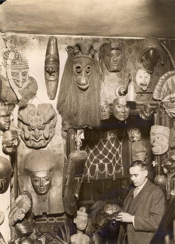 W.O. Oldman with masks and headdresses (image/tiff)