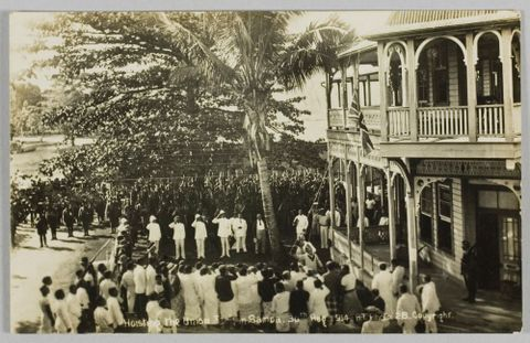 Postcard, 'Hoisting the Union Jack in Samoa. 30th Aug 1914.'