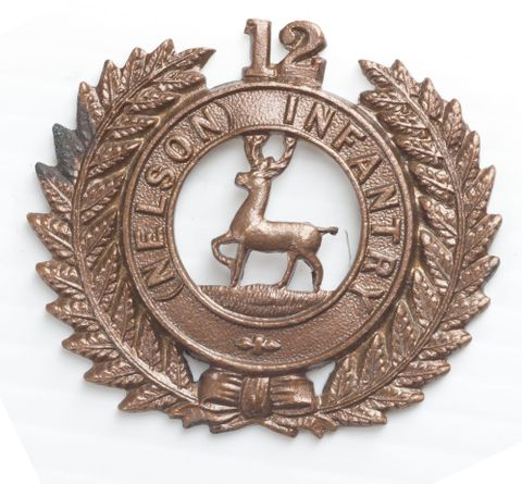 Cap badge, 12th (Nelson) Regiment, 1912-1916, United Kingdom, by J.R. Gaunt & Sons Ltd. Gift of the Defence Department, 1916. CC BY-NC-ND licence. Te Papa (GH021066)
