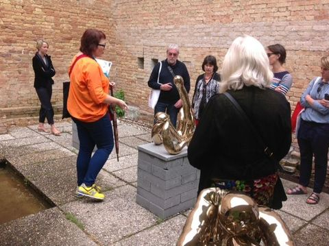 Patrons' tour, showing Sarah Lucas installation in the Carlo Scarpa garden, Giardini, photograph by Hamish Coney, 2013