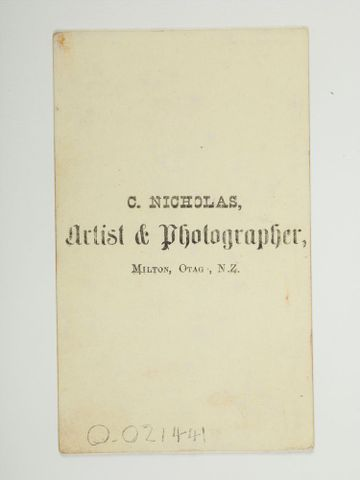 Back of photograph that says C Nicholas, artist and photographer
