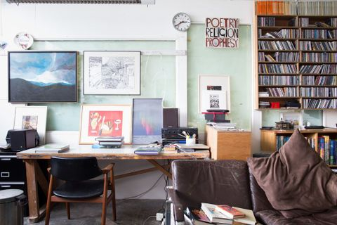 Karl Maughan's Mt Victoria studio showing Mark Reynolds painting (left) and Catherine Russ photograph (centre), August 2013. Photograph by Michael Hall, Te Papa