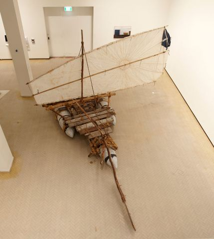 Michael Stevenson, <EM>The gift</EM> (from <EM>Argonauts of the Timor Sea</EM>), 2004–06, aluminium, wood, rope, bamboo, tar, World War Two parachute and National Geographic magazines, installed at Museum of Contemporary Art, Sydney Image courtesy MCA, photograph by Jenni Carter