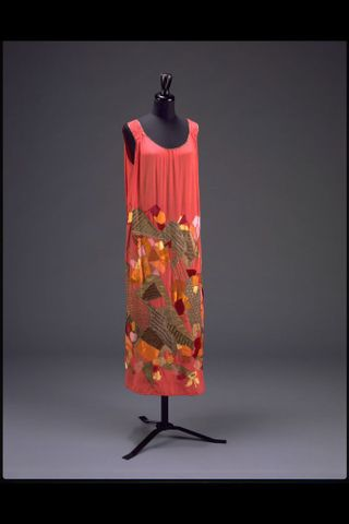 Natalia Goncharova for the House of Myrbor, <EM>Evening dress</EM>, about 1923, silk with embroidered silk and velvet appliqués with metal thread, bound with lamé, Victoria and Albert Museum, London © Natalia Goncharova/ADAGP. Licensed by Viscopy, 2013 / Victoria and Albert Museum, London