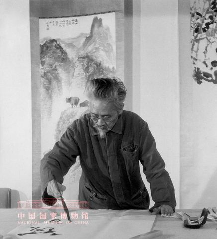 Shi Lu Painting a lotus flower