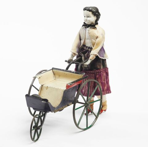 PC000570; Mechanical doll and perambulator; circa 1868; Goodwin, William M Farr ; view 1 (image/tiff)