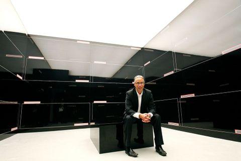 Darryn George sitting with his Venice Biennale 2013 installation work, <EM>Folder room</EM>