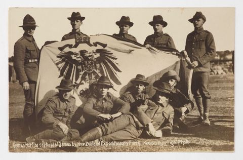 GH023107; Postcard, 'German War Flag captured at Samoa by New Zealand Expeditionary Force'; 1914-1916; Wilson, William Thompson ; Recto (image/tiff)