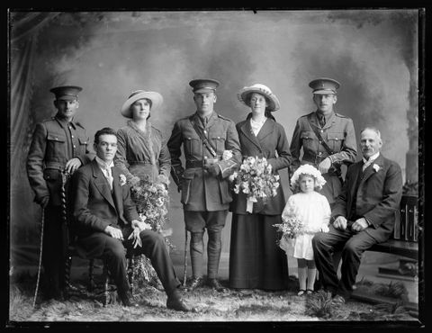 Portrait of Edmund Colin Nigel Robinson and his bride Mary Read, and wedding party