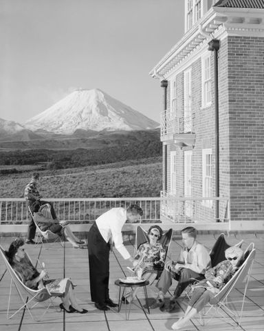 John Crichton's hammock chair represents ultimate lifestyle in this 1960 government photograph promoting New Zealand tourism. In 1957, the Tourist Hotel Corporation took over the Chateau Tongariro Hotel. Archives New Zealand Te Rua Mahana o te Kawangatanga, Wellington Office AAQT 6401 A66190