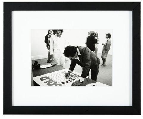 Peter Webb signing a <EM>Sold</EM> work by Billy Apple at the opening of <EM>Art for Sale</EM>, 1981, Peter Webb Gallery