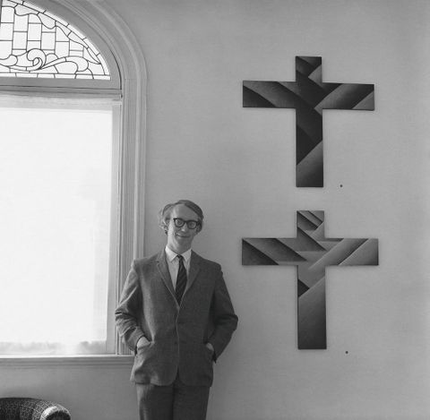 Peter McLeavey with Michael Smither's <EM>Fourteen Stations of the Cross, in memory of Rita Angus</EM>, September–October 1970, Peter McLeavey Gallery. Photograph by John B Turner.