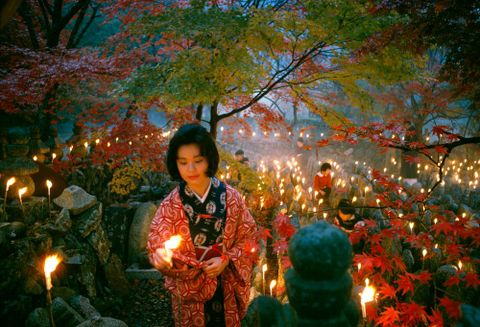 'Offerings to the unknown dead, Kyoto' [Toshi Satow offering a candle]. Taken for a series on Japan for 'Life'