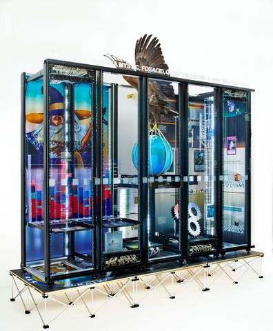Simon Denny, <EM>Modded server-rack display with some interpretations of imagery from NSA MYSTIC, FOXACID, QUANTUMTHEORY, and other SSO/TAO slides</EM>, 2015. Photograph by Nick Ash. Purchased 2015, Te Papa