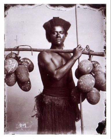 Fijian man carrying breadfruit