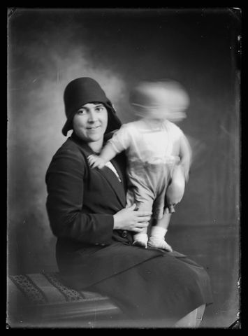 Woman holding infant boy