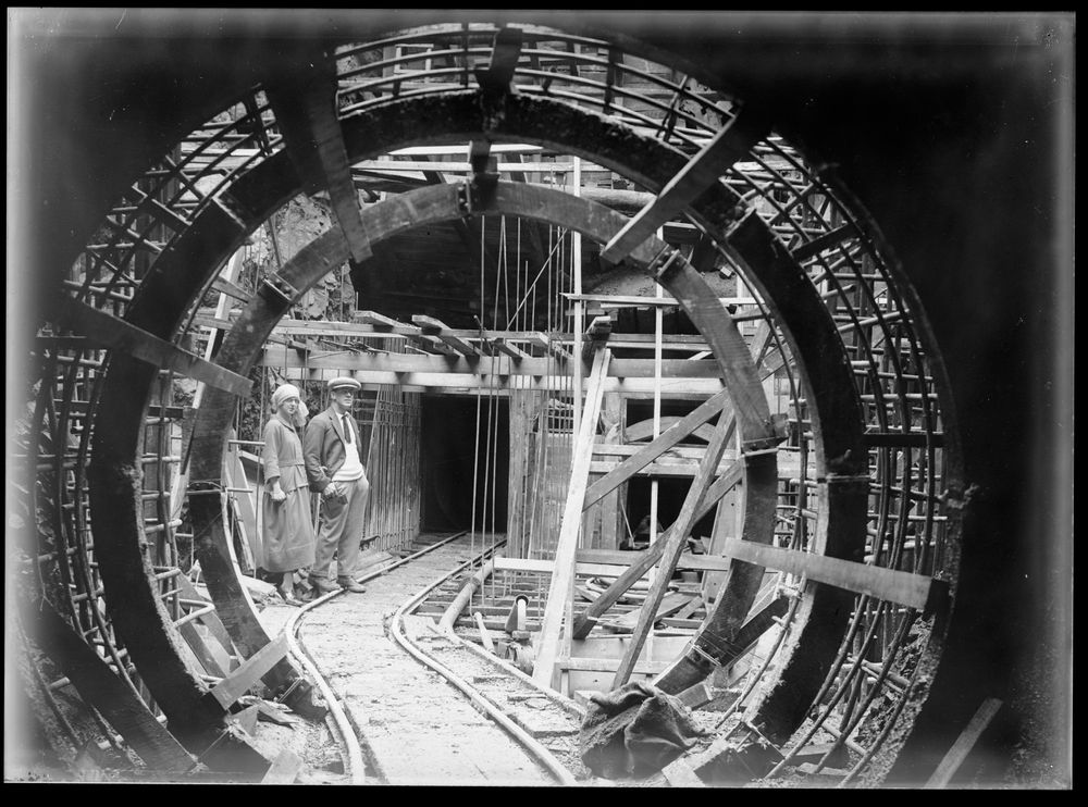 Leslie Adkin. Bill Walker and wife Emma in surge chamber no 1, Mangahao Hydro-electric power station, 20 May 1923. Gelatin silver print. Te Papa (B.022979)