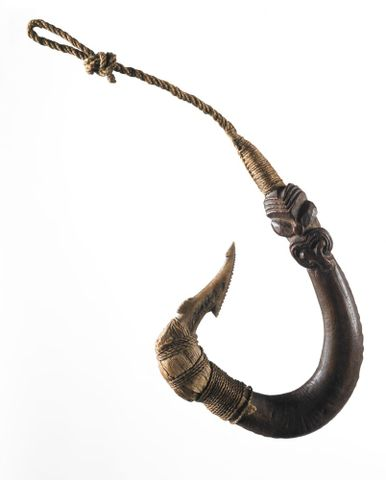 OL000105; Matau (fish hook); 1800-1850; Ngai Tahu  (attributed); Unknown; Shank is recorded as being made from native hardwood that has been trained to curve while still growing as a sapling. The underside of the shank has been notched giving it a se ; vi