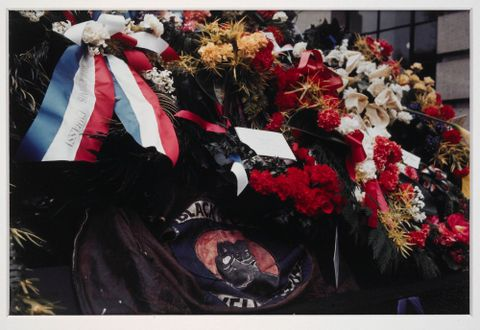 O.004307; Black Power jacket and wreaths on coffin of Norman Kirk; 09.1974; Miller, John (image/tiff)