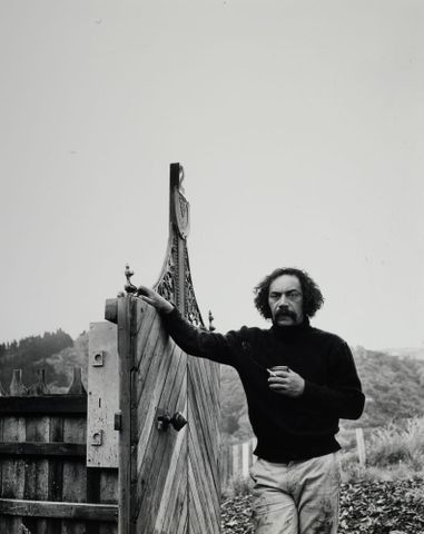 "O.027011; Ralph Hotere outside ""first studio"" on Flagstaff, Port Chalmers; circa 1976; Friedlander, Marti; without frame (image/tiff)"